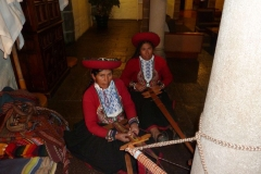 Ladies working on a traditional blanket